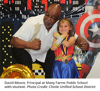 David Moore, Principal at Many Farms Public School with student. Photo Credit: Chinle Unified School District